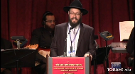 There is nothing like a holdup at gunpoint to make one realize that every day is a meaningful gift.  Rabbi Ari Shishler shares his experiences on shlichus in South Africa, illustrating how the unknown effect that we have on others can came knocking at the door.  Rabbi Shishler represents his fellow Shluchim and delivers the keynote address at the Kinus Hashluchim Gala Banquet.