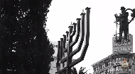 Giant menorahs in front of government buildings and in public squares have become a staple of the Holiday season and Jewish cultural and religious life, but the pioneering public menorahs of the 80's faced stiff legal battles.