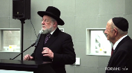 5 remaining children in the concentration camp are saved by the words of a 7 1/2 year old.  Chief Rabbi Yisrael Meir Lau is reunited with one of those 5 children at a Holocaust Memorial event