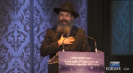 With remarkable passion and eloquence, Rabbi Nissan Dovid Dubov addresses the conference of Shluchim at the annual banquet. He conveys the Lubavicher Rebbe's message to his emissaries that he is with them wherever they go, using poignant, personal anecdotes. He empowers his fellow shluchim with an appreciation for the importance of their mission and th