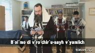 "The Mourner's Kaddish:       ""Yis-gadal v'yis-kadash sh'mayh rabo."" (Cong - ""Omayn"")   ""B'ol'mo di v'ro chir'u-sayh v'yamlich mal'chusayh, v'yatzmach pur'-konayh vikorayv m'shi-chayh."" (Cong"
