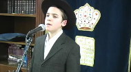 Boruch Tzfasman, a promising young singer, sings Avinu Malkeinu, a prayer we recite on Rosh Hashana and Yom Kippur.