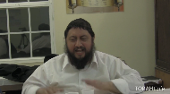 Rabbi Eli Silberstein sings a lively Chassidic melody at a Chassidic gathering.